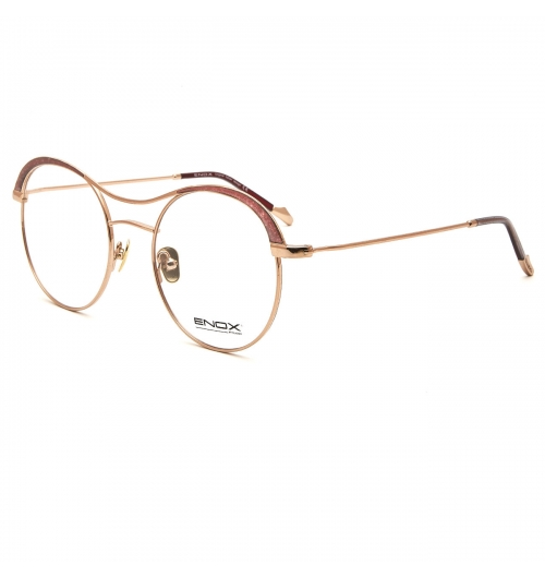 FLAM - The flagship model of the new ENOX collection for women. Shiny hypoallergenic metal, with a refined round shape design. The unique ciliary running along the two rings is enriched by special glitters on both sides which give a special light to the face. The same details are put on the acetate that covers the thin temples from with metal tip and high-relief logo. The nuances changes from silver, to gun, to the yellow or pink gold, red of the metals combined to the amber, turquoise, amethyst, ruby of the glitters. Equipped with nose pads of the same color that guarantee a universal fit, it is the essential model for all the sophisticated and trendy ladies.