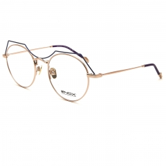 ORBIT - An optical frame of the new ENOX women's collection, made in hypoallergenic shiny/satin metal with a refined and cherished design. The slightly rounded shape of the front, surmounted by a stylized bridge which also goes like a double bridge, is joined by ultra-flat temples, a small ergonomic end tip, with drilled detail and engraved logo. Available in different colors, black, blue, plum, gold, silver, red differently combined. Equipped with nose pads of the same color that guarantee a universal fit, it is the model for all the sophisticated and trendy ladies who do not want to compromise on comfort.