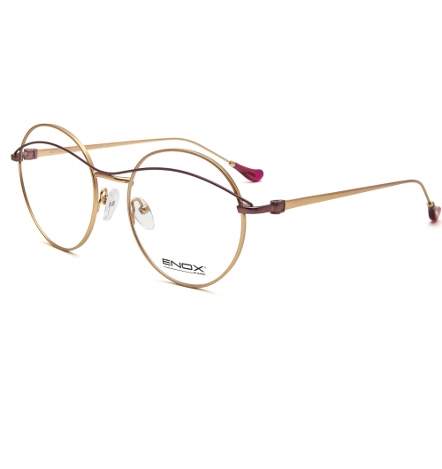 CRAMER - An optical frame of the new ENOX women's collection, made in hypoallergenic shiny/satin metal with a refined and cherished design. The very rounded shape of the front, cut by a thin ciliary which passes through the upper part of the eye and also goes like a double bridge, is joined by ultra-flat temples, from the small ergonomic acetate end tip. Available in different colors, gold, silver, burnished and light gold combined with details in blue, plum, red, black, brown. Equipped with nose pads which guarantee a universal fit, it is a fine and elegant but also comfortable and trendy model.