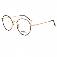 DILLER - Unisex optical frame model of the new ENOX collection, round shape made in shiny and satin hypoallergenic metal, with thin metal and acetate temples and drilled metal end tips with high-relief logo. Available in different colors, from the new pink, dark blue, dark purple to the evergreen black and turtle, harmoniously combined with gold, aluminum and gun.  Equipped with nose pads matching with the metal that guarantee a universal fit, they are spectacles to wear for a breezy style and absolute comfort.