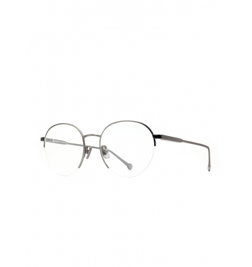 Buschdoktor Silver Gunmetal - Meet the newest addition to our expanding eyewear family! The warmth and organic beauty of nature is met with the stability and precision of titanium. The classical design allows both materials room to stand out yet unites their contrasts in one exceptional frame two. The results speak for themselves. The results speak for themselves: spectacularly elegant featherweights, delicate yet unbreakable. Finally the look is completed by subtle micro engravings- detectable only to the most attentive and discriminating observer.