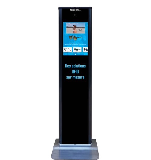 RFID Totem - Virtual fitting - Dynamic digital display for customers  The RFID Totem is a kiosk that displays information when reading products with RFID technology or when browsing available products.  Attractive and fun, this kiosk guides the customer through its choice while offering digital interactivity in your store.  Thanks to this totem, the client is autonomous and can:  Read a product and consult its details Browse the products from the catalogue Virtually try on unavailable products and/or colors Take pictures with products Obtain advice from head shape (coming soon)