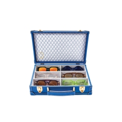 Micro Trunk - Hand-made Royal Blue luggage with white exterior contrast stitching and a diamond tufted interior liner. Holds 6 of your favorite spectacles. The most exclusive way to travel with your eyewear. 4 Colorways available