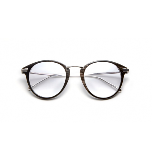 Natural Horn - Bespoke spectacles designer Tom Davies reveals his latest Natural Horn collection for Autumn/Winter 2019. Tom Davies' new Natural Horn collection was inspired by some of his best-selling ready-to-wear acetate shapes and styles.  Natural horn is the perfect material for those who love a luxury frame but prefer a more muted modern look. This material is special for many reasons: not only is it ethically sourced and environmentally sustainable, it is also 100% hypoallergenic, making it a perfect material for those with sensitive skin.  No two pieces of horn are ever the same--they are essentially as unique as a fingerprint. Customers who choose a natural horn frame can be sure they will have a one-of-a-kind design, perfectly made just for them.   Our horn frames are composed of razor-thin slices of layered horn laminated with carbon fibre sheets between the horn. The result is a striking and lightweight collection of spectacles and sunglasses with slender frames that are easy to wear and contemporary.